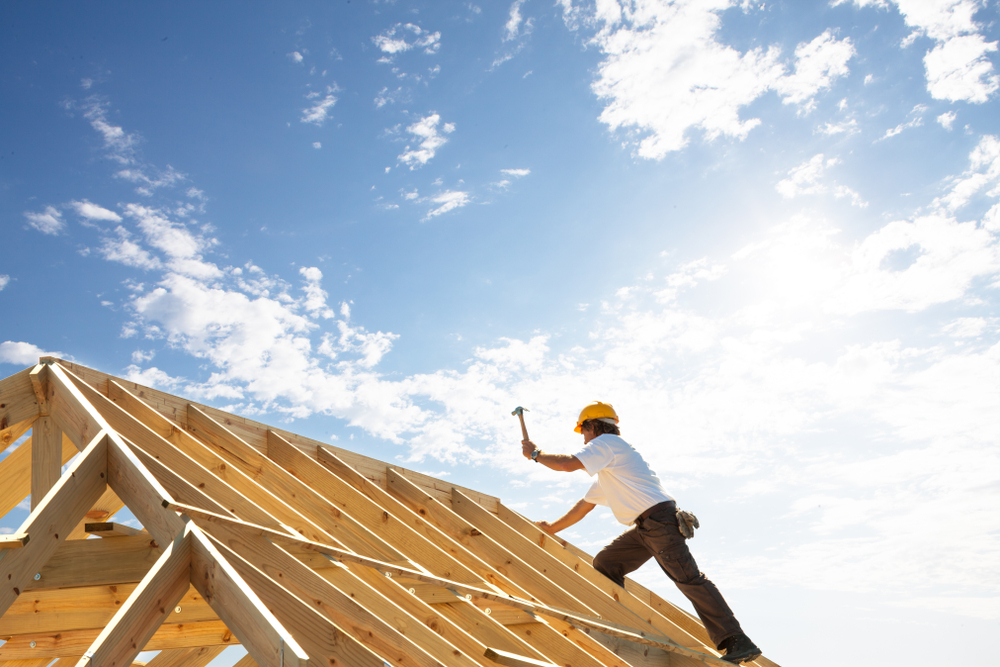 worker working on a roof