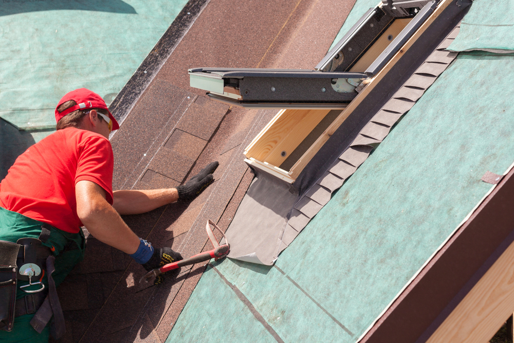 A roofer checking Roof Damages
