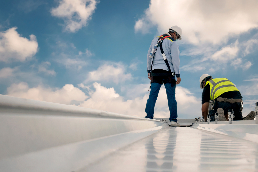 Roofers on top of the commercial roof
