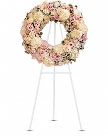 Peace Eternal Wreath    Gorgeous pink hydrangea, crème roses, light pink spray roses, white chrysanthemums, waxflower and more are adorned by pink organza ribbon in this eternal circle of peace.    Shop Now>>