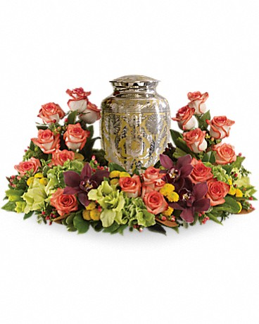 Sunset Wreath    A rich and subtly hued garden expresses sympathy most thoughtfully, in a gentle oval arrangement that honors and embraces a cherished memory. Orange roses blend with other beautiful flowers such as stems of cymbidium orchids, gladioli, chrysanthemums, hypericum and other delicate greens.Please note: Arrangement does not include urn.    Buy Now>>