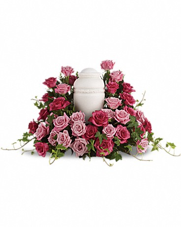 Bed of Pink Roses    A loving embrace. A beautiful gesture. A respectful tribute. A wealth of pink roses create a soft, serene and dignified way to cherish and honor the departed. An awesome display of pink roses are lovingly arranged with ivy and other gentle greens to display the urn.Please note: Arrangement does not include urn.    Buy Now>>