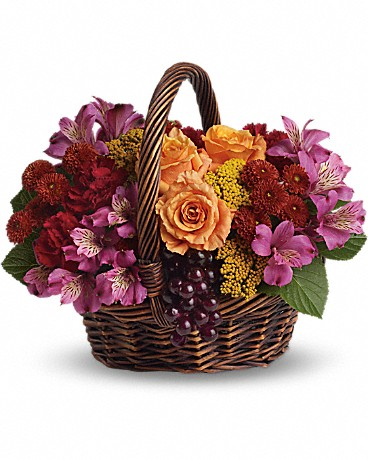Sending Joy    Know anyone who would really appreciate a basketful of joy right now? Send love and flowers with this beautiful array of fantastic fall flowers. The basket overflows with orange roses and spray roses, maroon carnations, purple alstroemeria, burgundy button spray chrysanthemums, yarrow and even a bunch of grapes (not real, of course)!    Buy Now>>