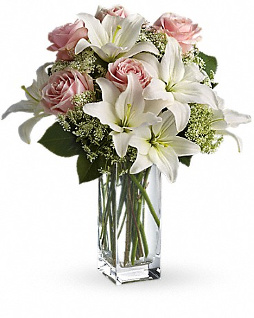 Heavenly And Harmony    Heavenly hues and pretty petals are in perfect harmony in this gorgeous arrangement. Lovely for a birthday, anniversary or just because, it's simply stunning! Light pink roses, white asiatic lilies, Queen Anne's lace and salal are beautifully arranged in a glass vase. Heaven sent? Well, someone will think you're an angel for sending it!    Buy Now>>
