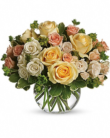 This Magic Moment    It will be a magic moment when this divine bowl of pastel roses is hand-delivered to someone special. Perfect for any occasion, the soft colors and variety of rose blossoms will soothe anyone's soul. Beautiful yellow roses, peach and white spray roses and greens are delivered in a clear glass bubble ball. The effect is magical.    Buy Now>>