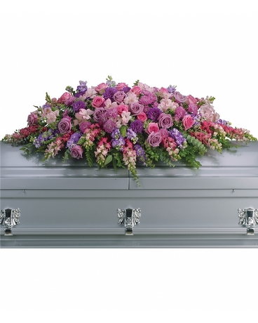 Lavender Tribute Casket Spray    Like a heartfelt embrace, this beautiful casket spray has lavender and pink roses, snapdragons, alstroemeria, chrysanthemums, fern, eucalyptus and more create this tribute that is overflowing with grace and love.    Shop Now>>