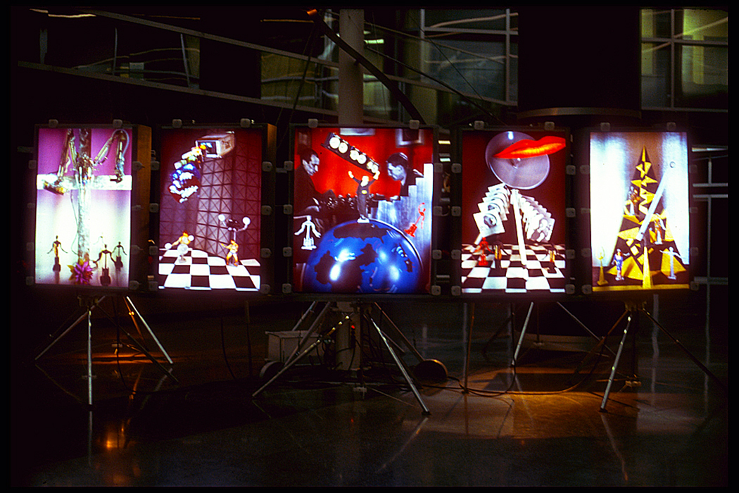 "PHSCologram '83  by Ellen Sandor, Jim Zanzi, Mark Resch, Randy Johnson, and Gina Uhlmann, (art)n and Gary Justis, Jerry August, Tom Cvetkovich and Steven Smith. 5 32"" × 48"" PHSCologram panels, Cibachrome, Kodalith, Plexiglas featuring tributes to Georgia O'Keeffe, the Outsider Artist, Marcel Duchamp, Man Ray, and Louise Nevelson. Exhibited at SAIC, Fermilab, and other venues, and featured in the  New Art Examiner  cover story, January 1984. Courtesy of Ellen Sandor, (art)n."