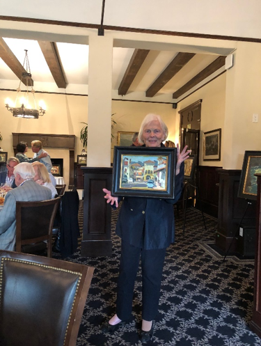 Left to Right: Berta Binns with painting she acquired.