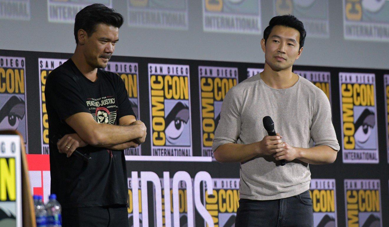 Director Destin Daniel Cretton (left) and Simu Liu at Comic-Con