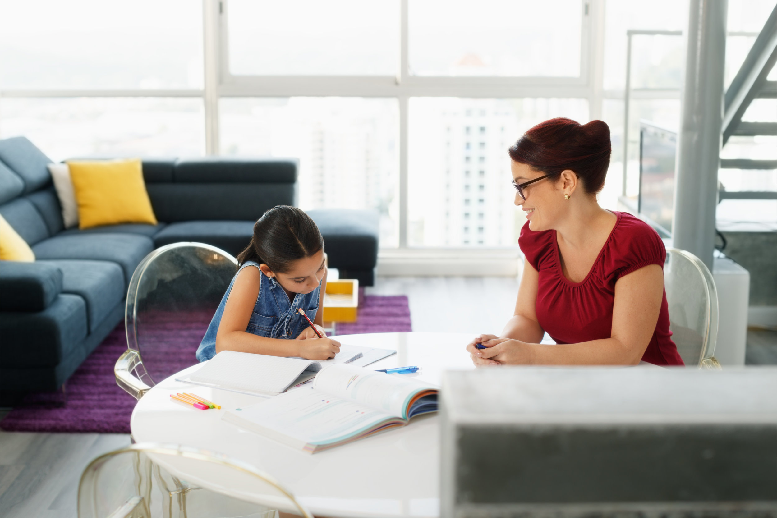education-with-mom-helping-daughter-doing-school-PEH56DY.jpg