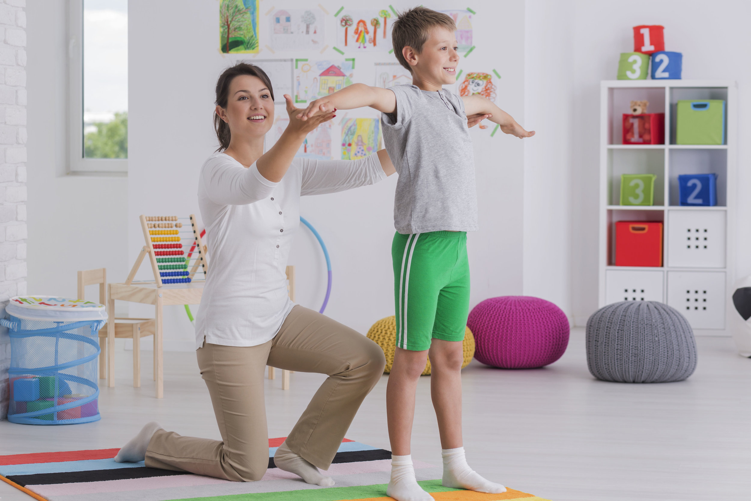 physiotherapist-exercising-with-a-school-boy-P856T63.jpg
