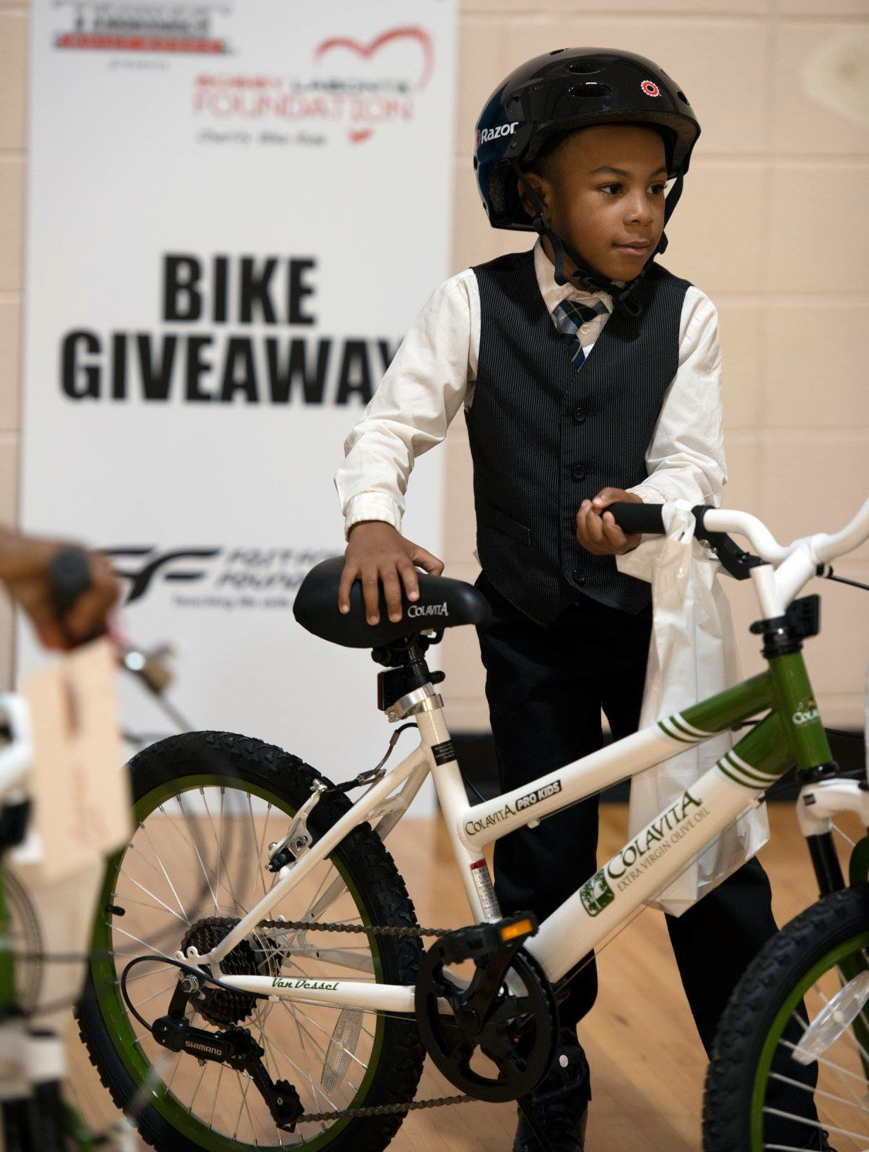 In 2018, Colavita supported the Bobby Labonte Foundation in order to surprise more than 80 children in need with a new bike and helmet. photo credit: colavita