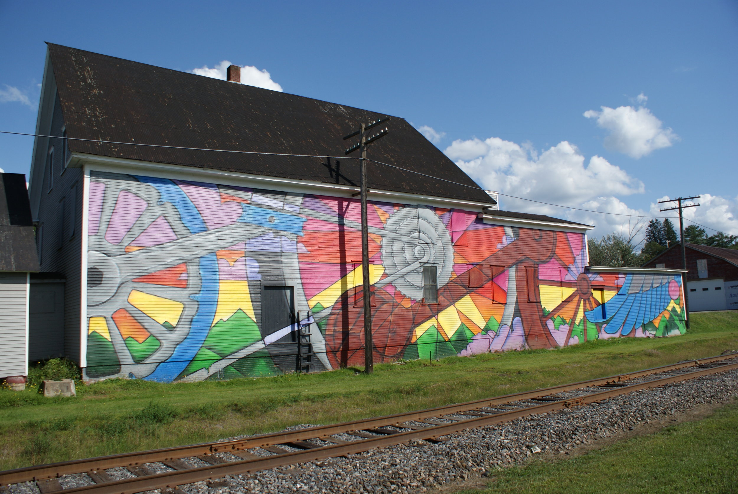 Mural in downtown Lyndonville, Vermont, by artists Scottie Raymond and Brian Clark of the Anthill Collective in Hyde Park. The mural was painted in October 2018 as part of a downtown revitalization effort.