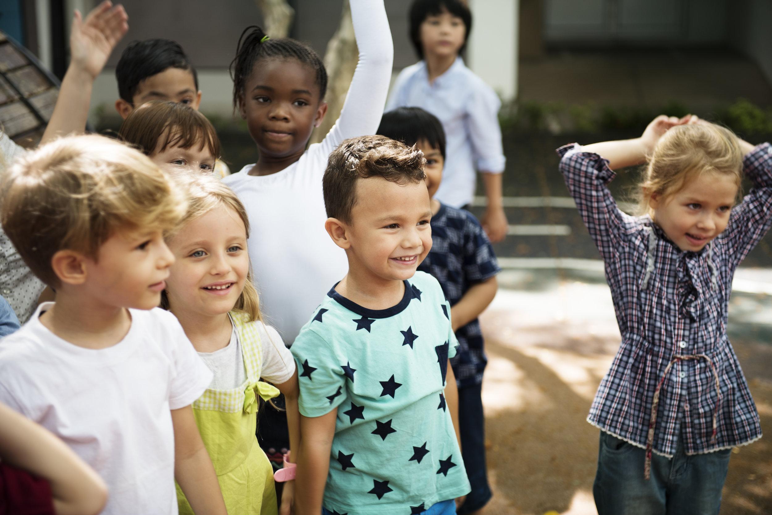diverse-kids-standing-together-PU3B4SB.jpg