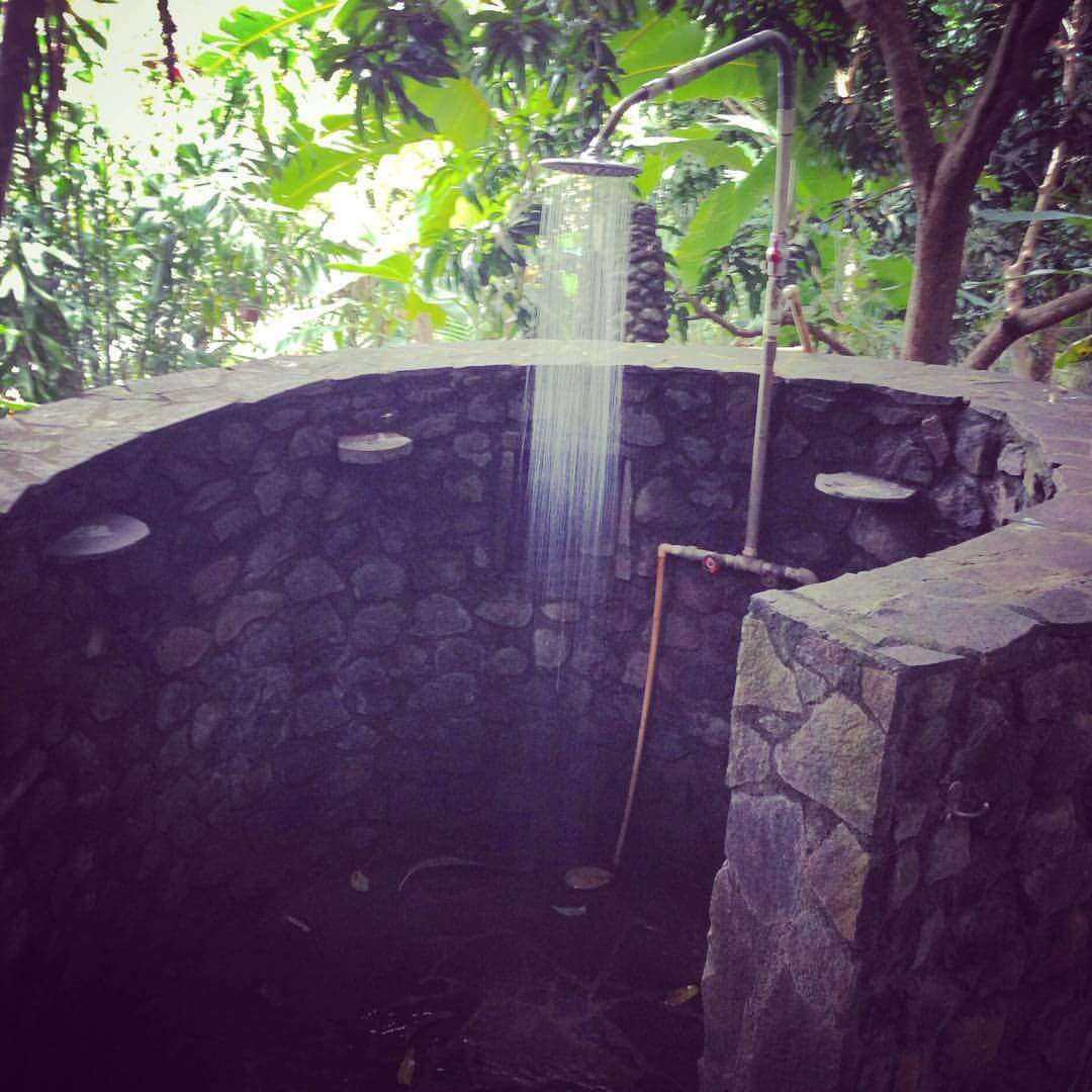 Optional outdoor spiral shower, solar-powered hot water system