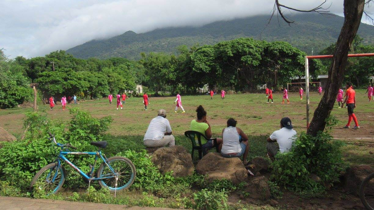 Balgue Community watching a local match in the town