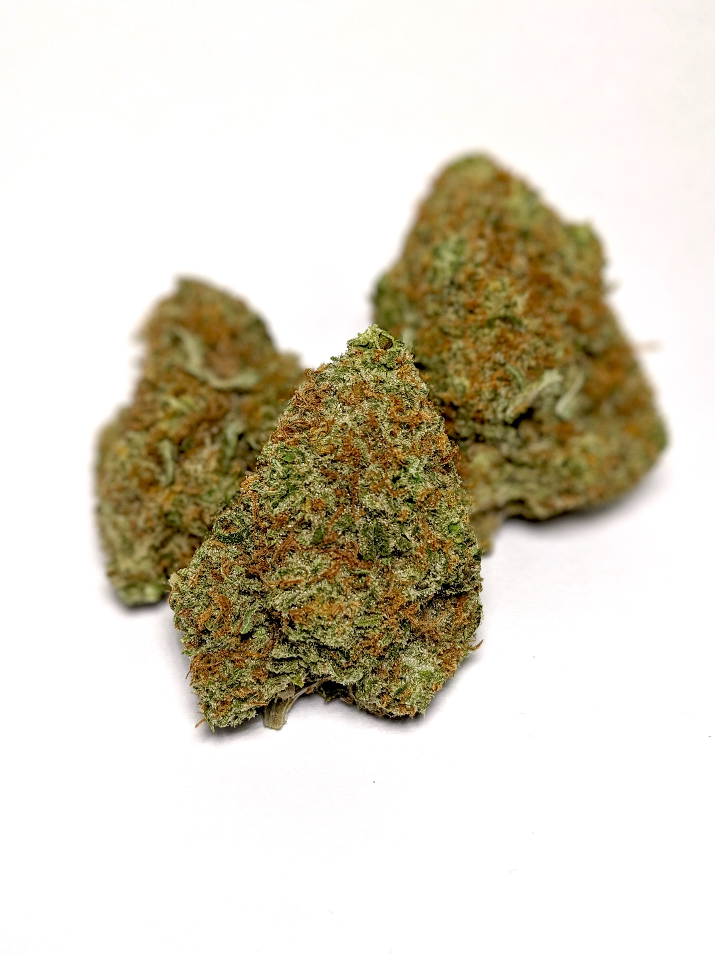 "Platinum OG - Indica    1/4- $65 1/2-$110 OZ-$200   Platinum OG is just as precious as the metal it's named after. With a THC content regularly topping 20%, this indica-dominant hybrid asserts itself as one of the ""heaviest"" strains around. Platinum OG is purported to stem from three strains:  Master Kush ,  OG Kush , and a third unknown parent. Flowers are lime green and plump, with prominent orange hairs and a platinum coating thanks to the abundance of THC crystals. A brief, heady onset settles into a powerful physical sedation suitable for nighttime use and pain, stress, or anxiety relief, making this precious strain a robust healer."
