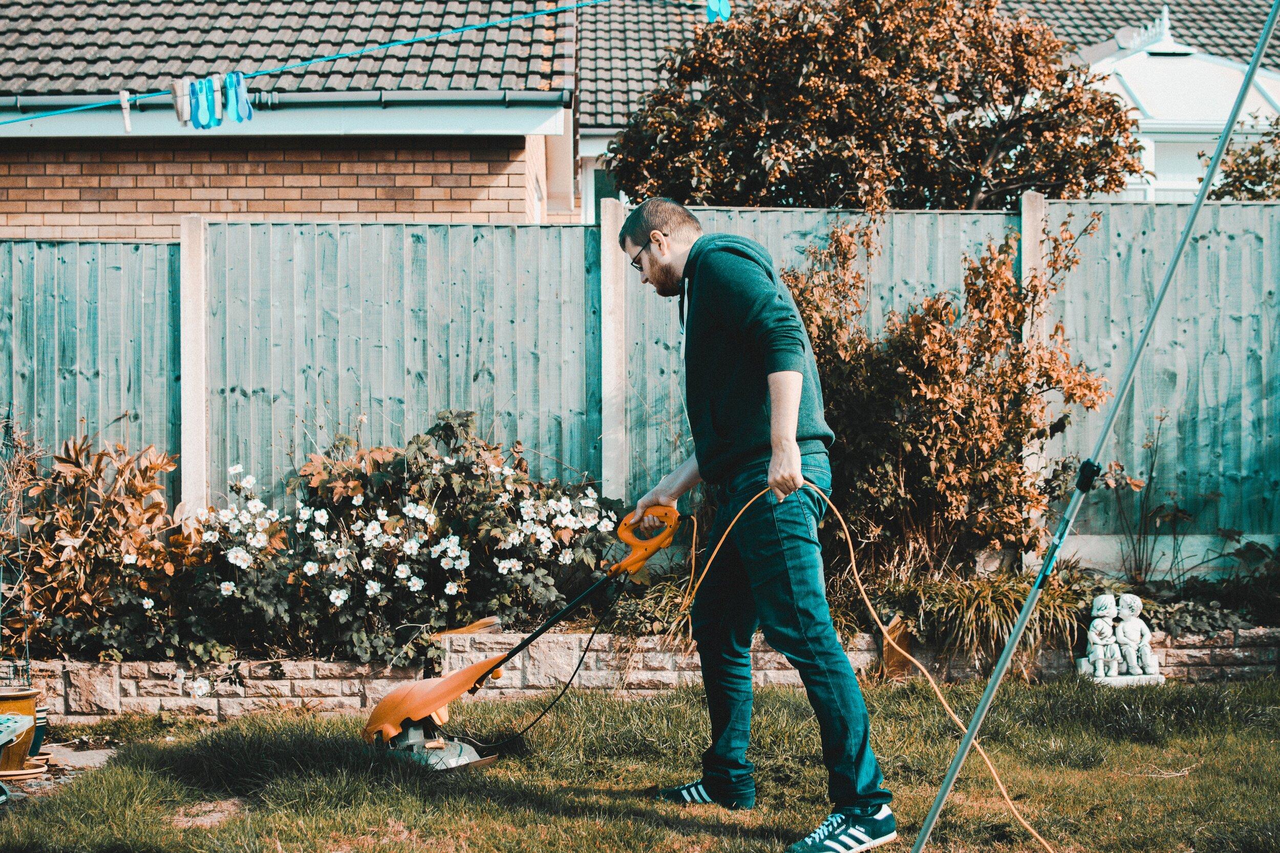 https://www.pexels.com/photo/man-holding-orange-electric-grass-cutter-on-lawn-1453499/