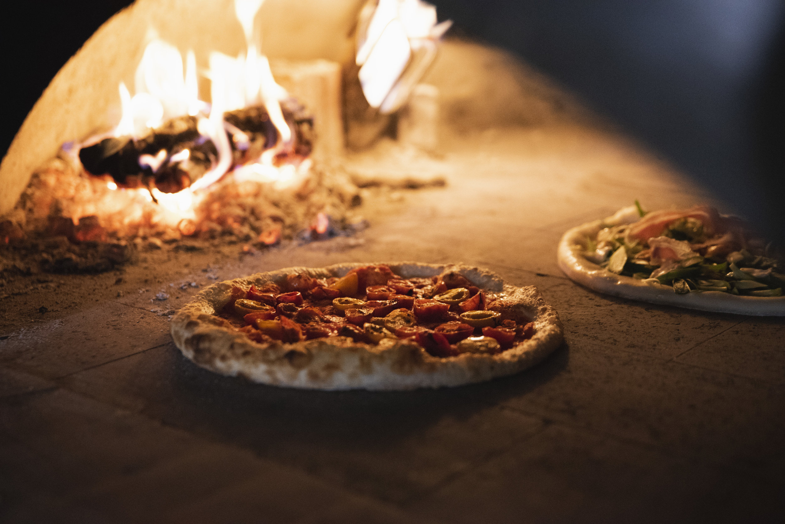 Pizza cooked in our wood-burning oven.