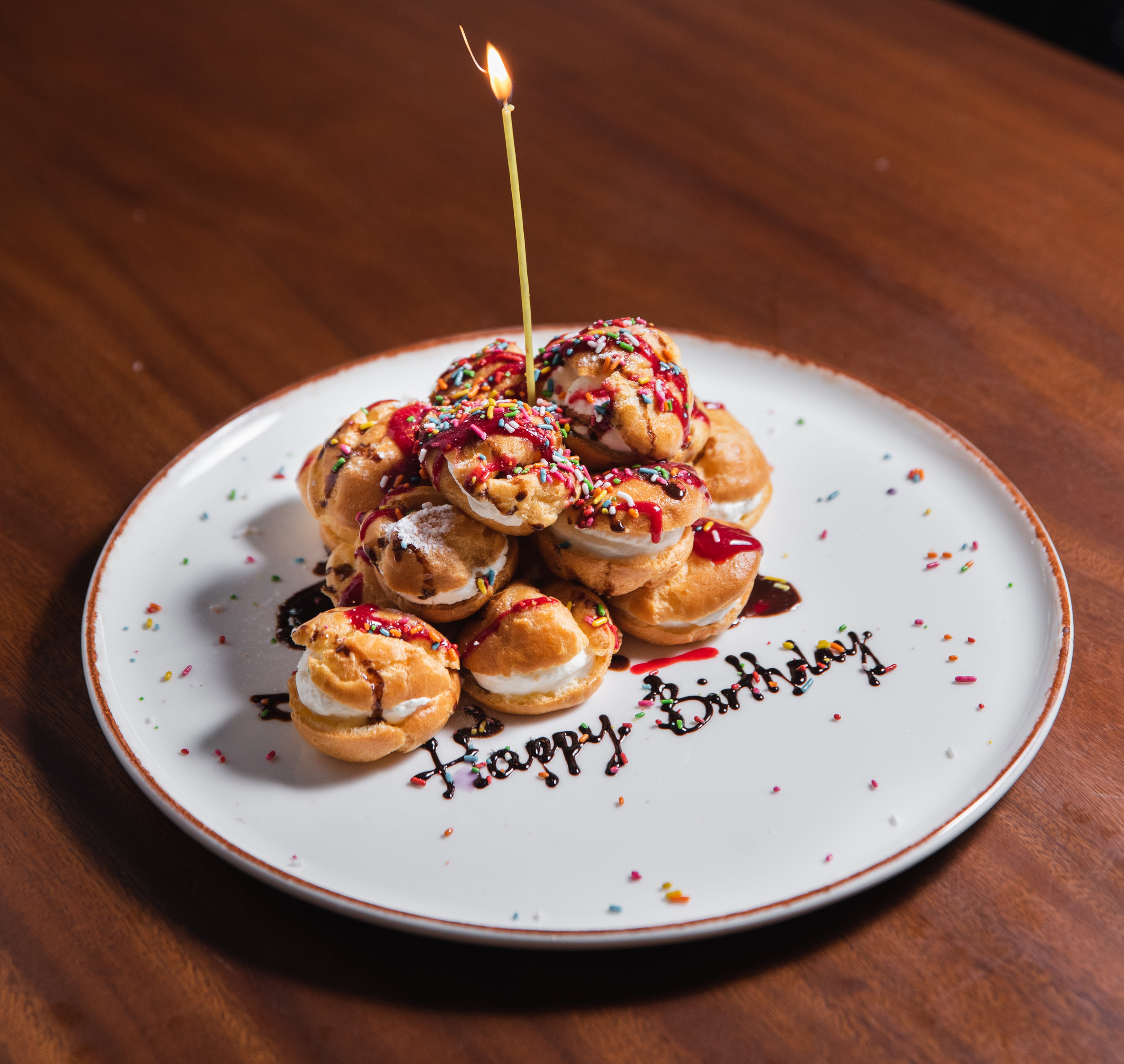 What's a celebration without something sweet?   Choose from three options available:   1. Cakeage Charge ($15)   Bring your own cake and leave it to us to serve.   2. Dark Chocolate Birthday Tart by Tarte by Cheryl Koh ($75)   Serves 8 – 10 pax  2 days advance notice required   3. LINO Birthday Dessert   Up-sized version of in-house dessert options  2 days advance notice required  Please  call  for more information