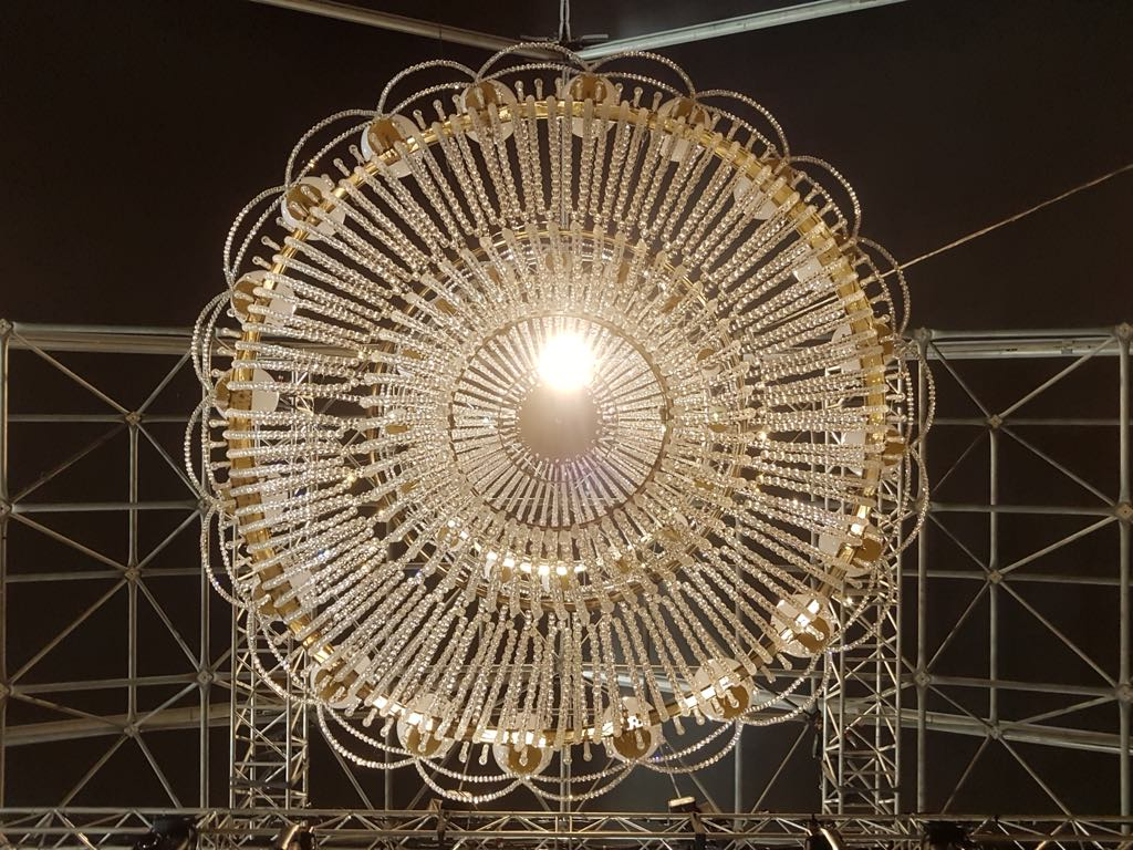 Admiring the symmetry of the chandelier