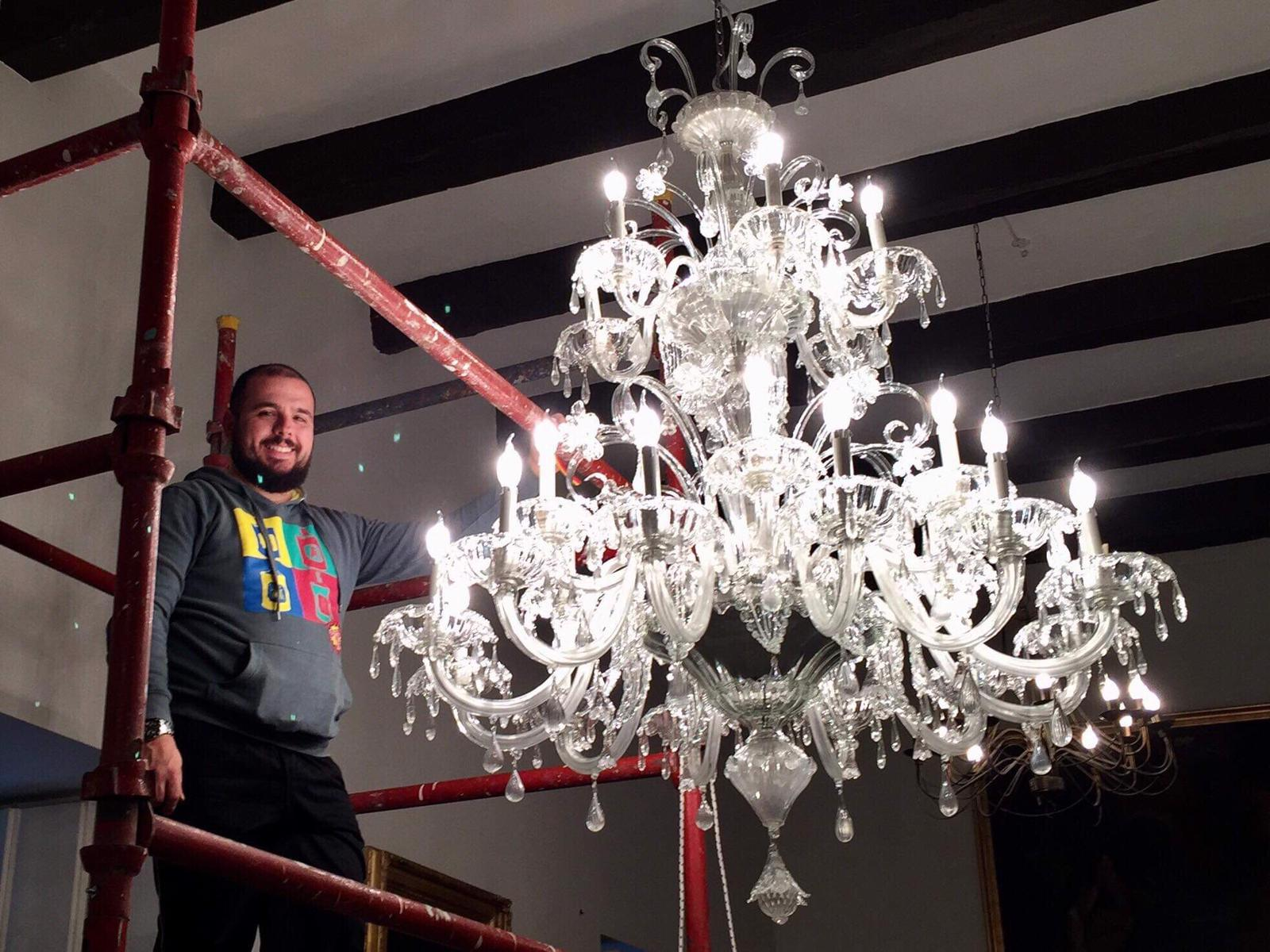 Admiring the beauty of this Murano chandelier