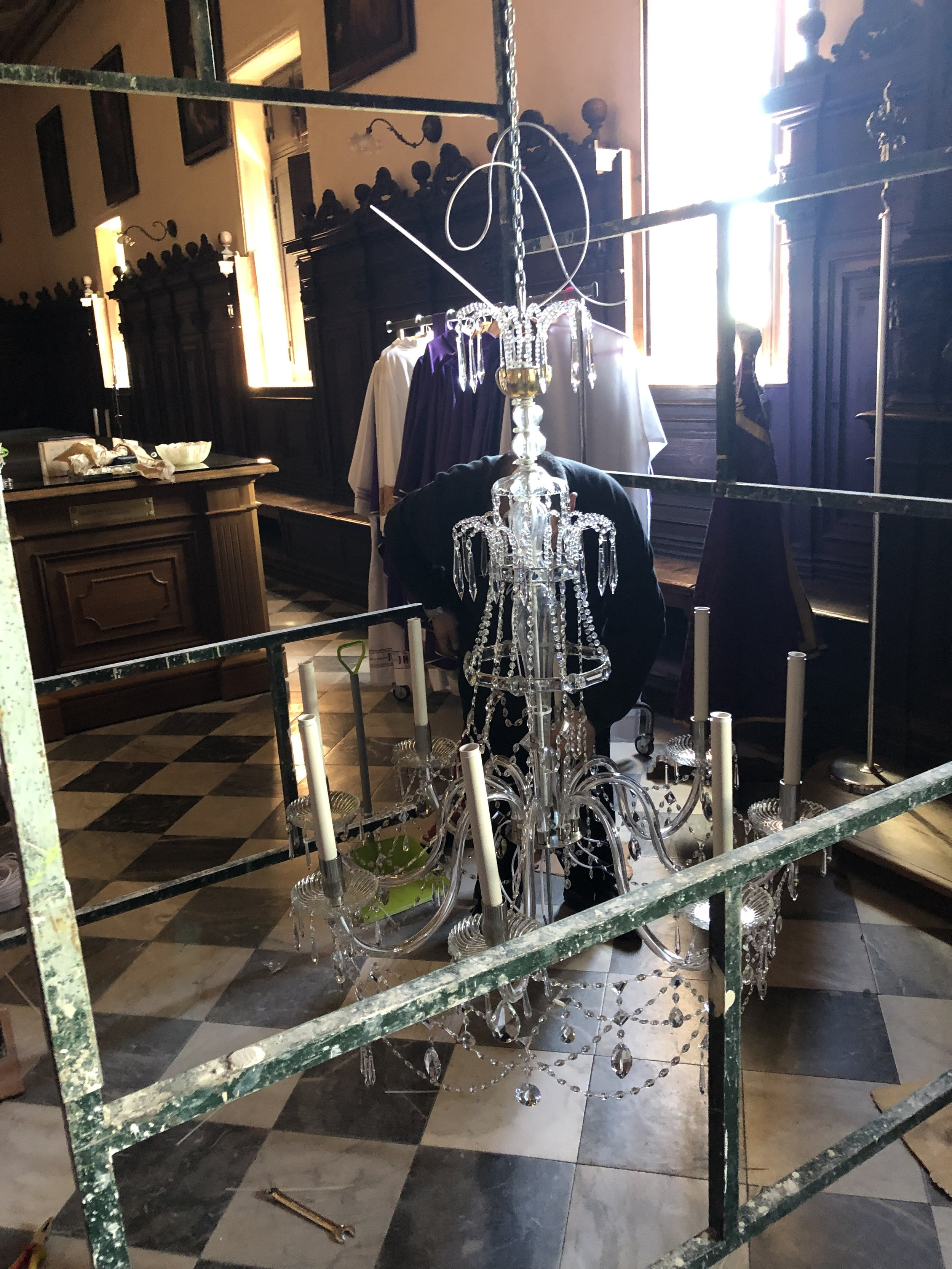Installing the restored chandelier