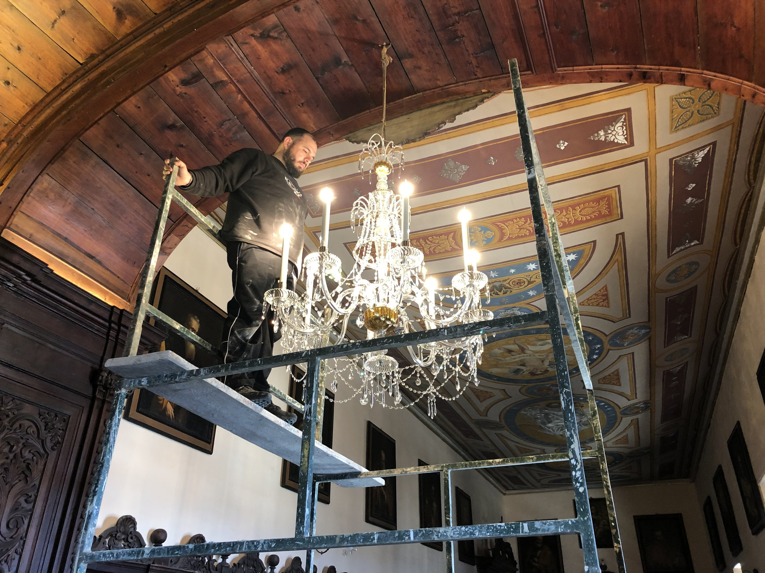 Checking and admiring the chandelier