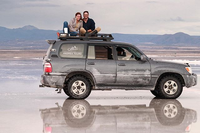 One of my favorite pictures from one of my favorite days. Thanks especially to @andrea.tours and @anywherevacations for making our dream a reality! . . Pro tip: *especially* if you are going during the rainy season, make sure you plan enough time in the Salt Flats to see the sunset! We were able to see it from the airport, but we know it would have been incredible to be in the Salt Flats during that time! . . . . . . #touruyuni #saltflatsbolivia #uyunisaltpic #salardeuyunibolivia #uyunibolivia #travelbolivia #couplewhotravel #salaruyuni #travelcouplelife #boliviatravel #igersBolivia #travelcouplegoals #explorebolivia #visitbolivia #mytravelpics #uyunisaltflats #experiencebolivia #couplesthattravel #saltflats #salardeuyuni #uyuni #visitsouthamerica #beautifuldestinations #bolivia #southamerica #globetrotter #travelpics #traveladdict #travelblogger #travelling
