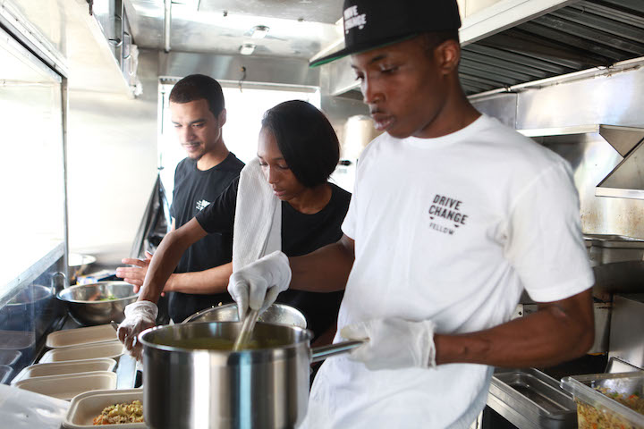 Fellows working on the Drive Change food truck.