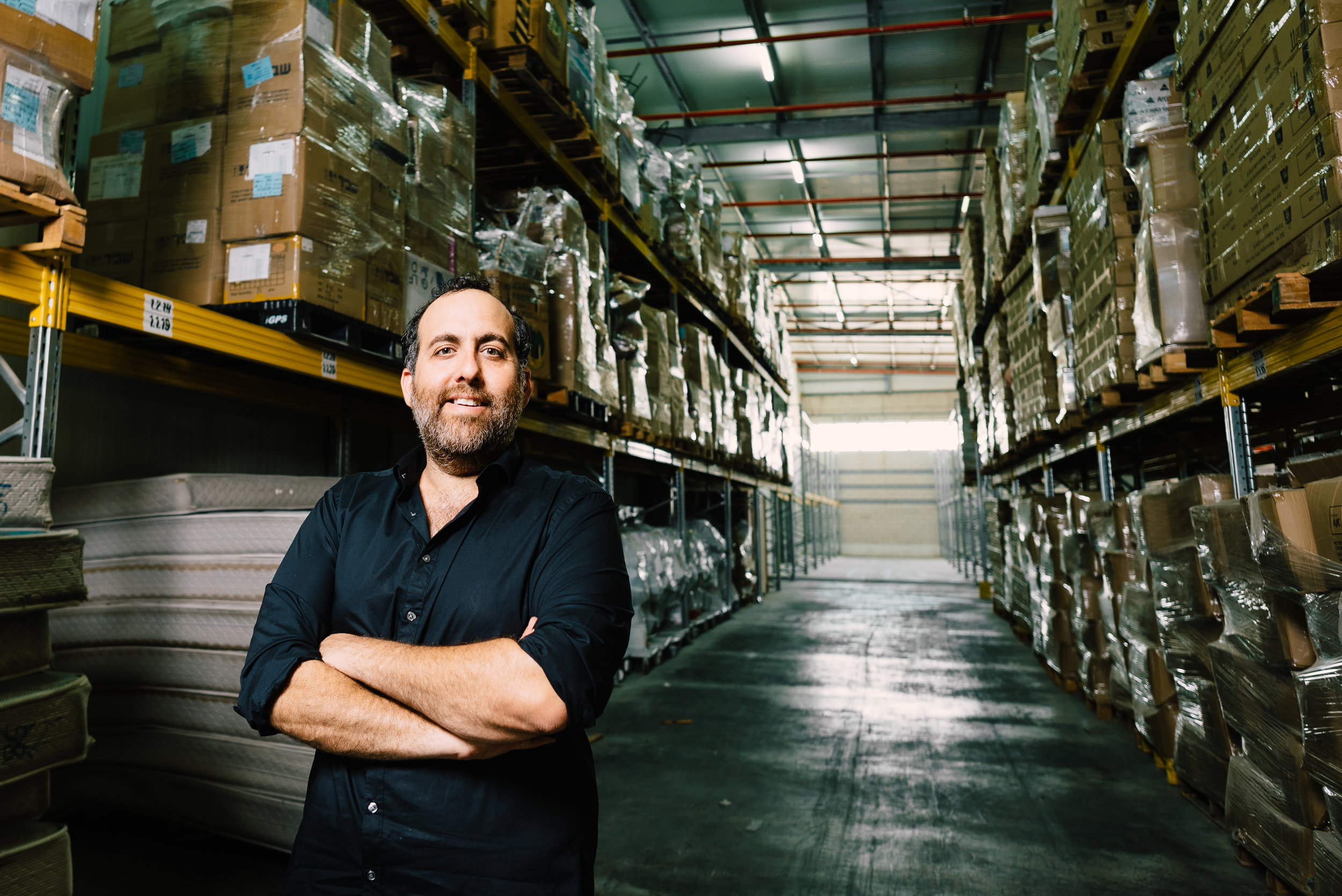 Founder and CEO of Social Delivery Tomer Shemesh at their warehouse of collected surplus goods in Israel.