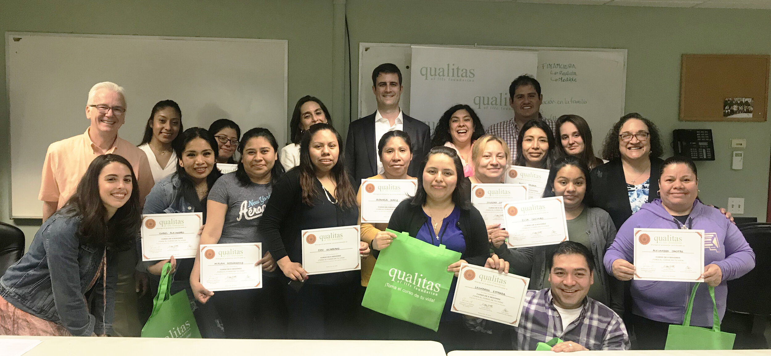 Participants graduate from a financial education course in the Bronx, NY