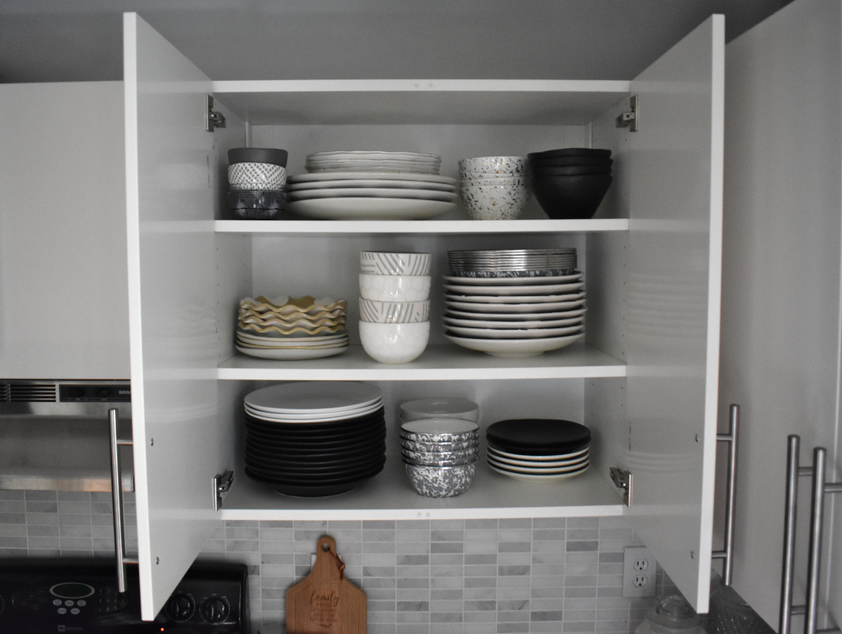 I somehow accidentally registered for 4 different sets of dishes and loved them all enough that I didn't want to return anything or lose much of what I had before. But I did manage to organize this cabinet enough that it all fits and isn't completely overwhelming to find what you're looking for. Everyday stuff on the bottom shelf and fancier stuff up top. Plus I can set a pretty badass table.