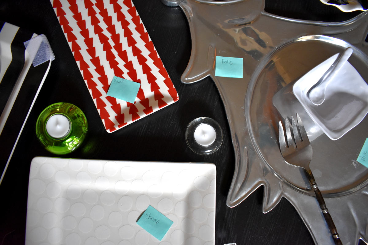 PLAN SERVING PIECES + LABEL EACH - Set your table in advance so you know exactly which pieces you're using for each dish. Label each so that helpers can easily identify what goes where. Don't forget forks, spoons, or tongs!