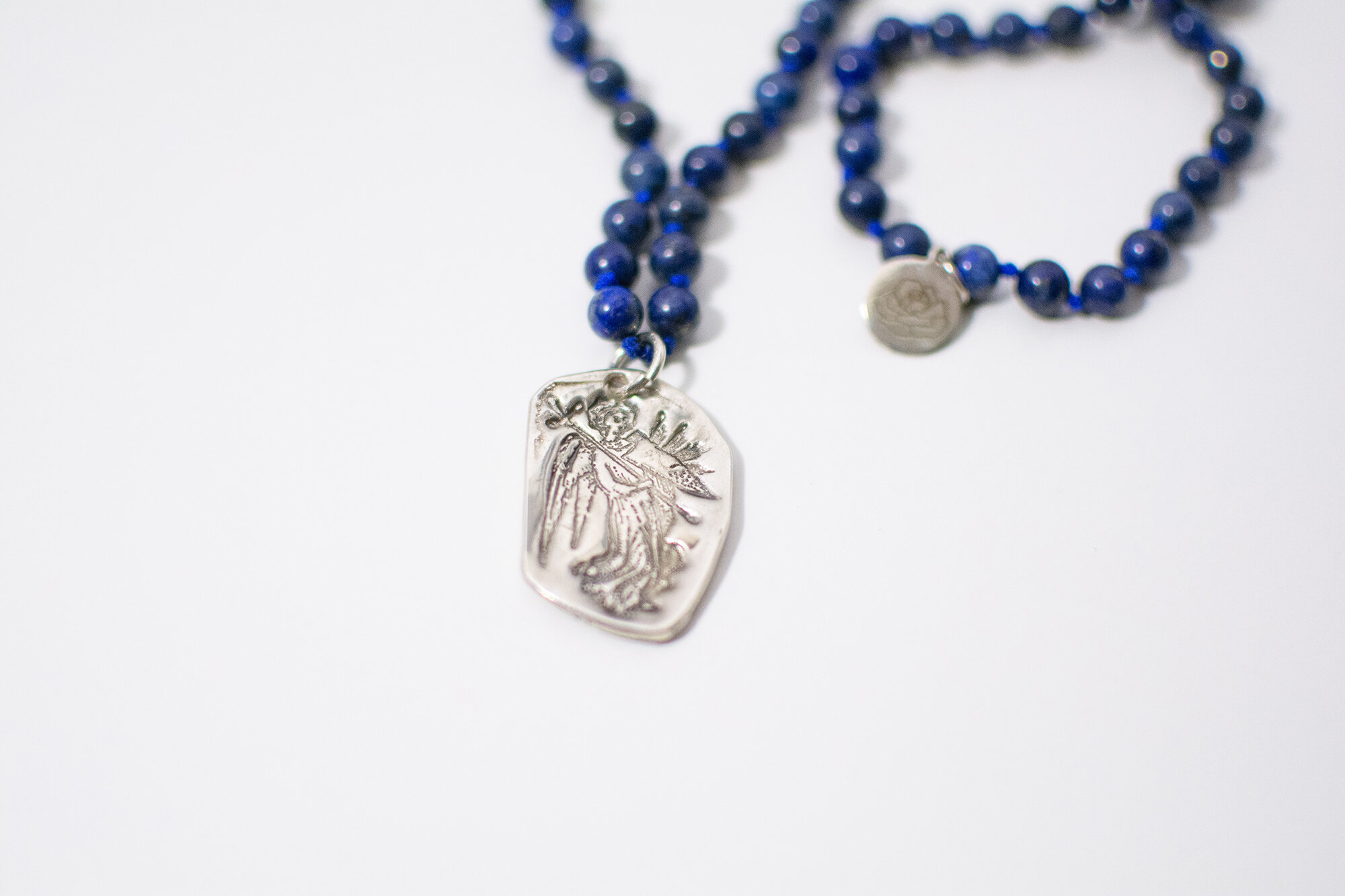 Angels frequent our collection! Here is Gabriel in an outstanding handmade silver charm adorning pure lapis.