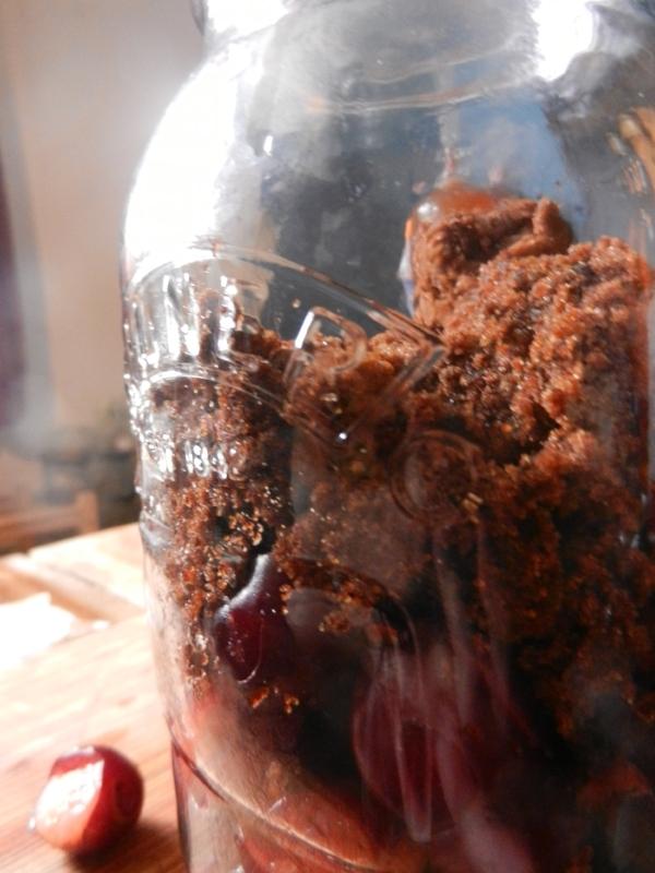Cherries and muscovado sugar in a kilner jar