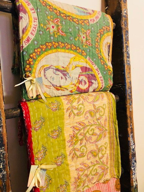 Kantha quilts_on ladder_in store.jpg