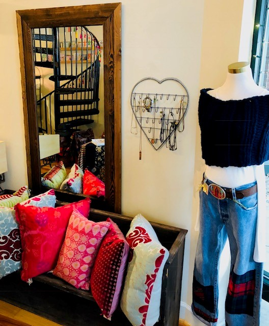 Sara Peckham pillows_bench_clothes_in store.jpg