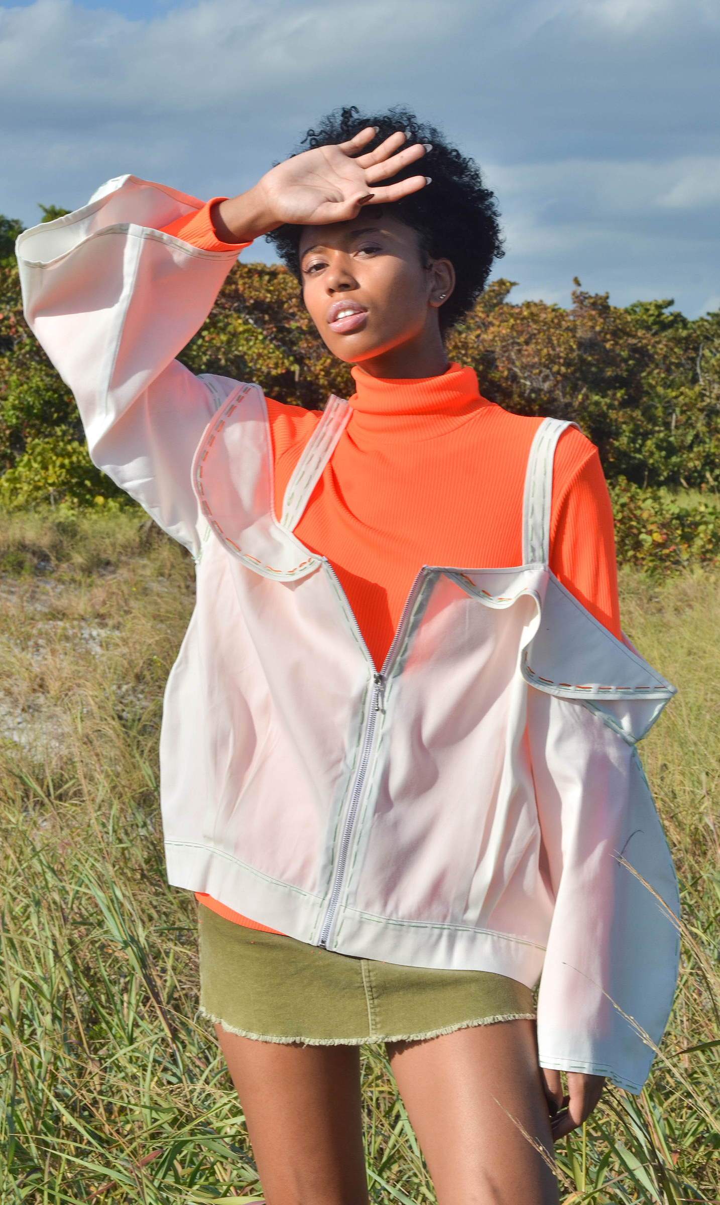 The  Off The Shoulder Jacket  is not only fashionable but it's fun. The orange and green top stitching adds an artistic flare and can be stylishly worn dressy or casual.