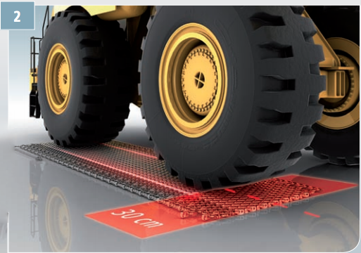 2. Move the wheel loader until the tire reaches the shown position.