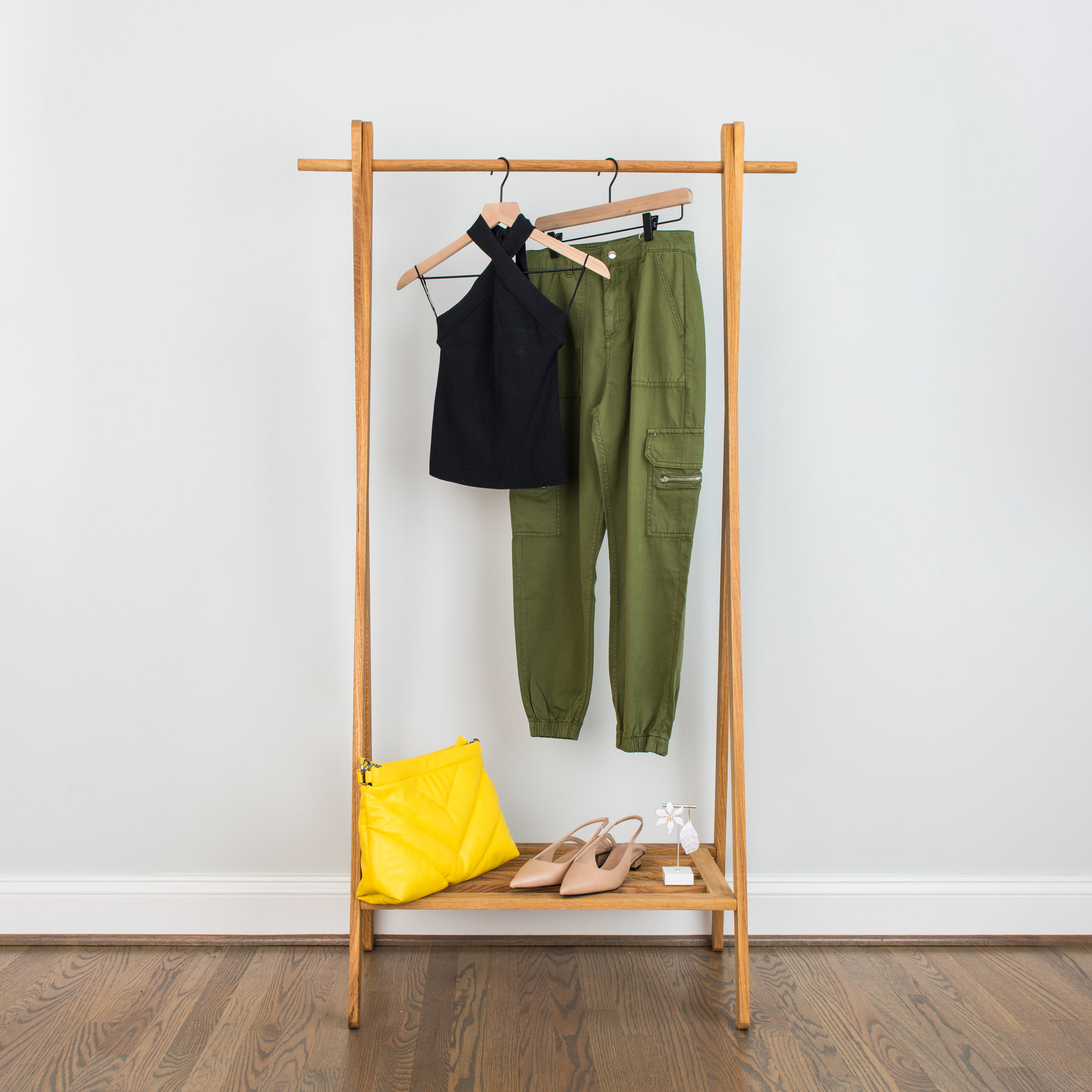 """cargo night - The cargo pant is the new """"jean"""" for a night out this Fall. Pair it with a sweater tank or halter and some slingbacks and it's perfect for a dinner out.Knit Halter/Tank: 1 // 2 // 3Green Cargo Pants: 1 // 2 // 3Slingbacks: 1 // 2 // 3Mismatched Earrings: 1 // 2 // 3Oversized Clutch: 1 // 2 // 3"""