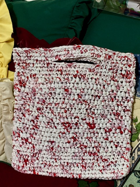 This bag is crocheted from plastic bags. You cut up the bags and create something called plarn (plastic yarn) then you crochet. Amazing!