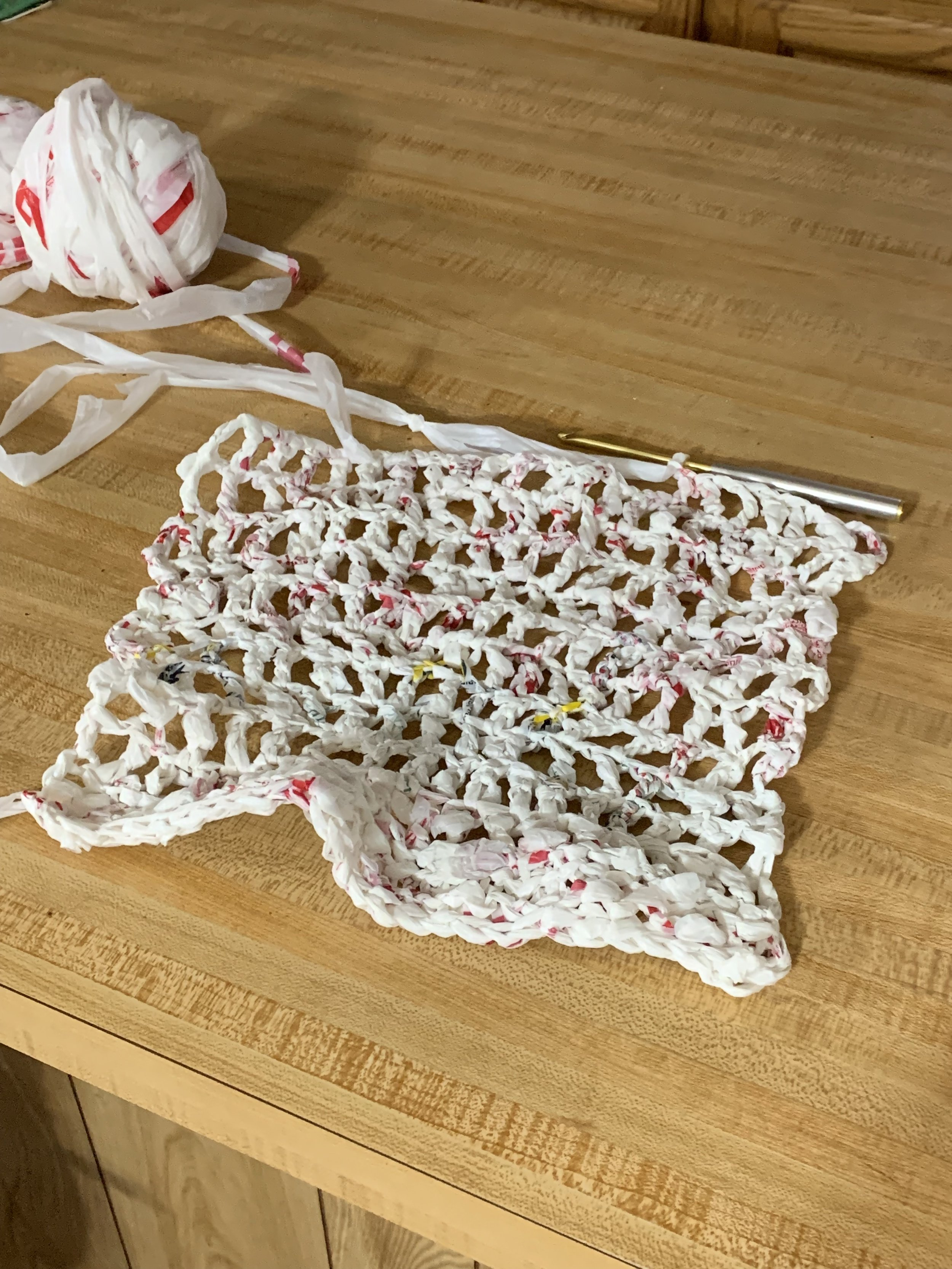 The beginnings of my first tote bag made of plarn.