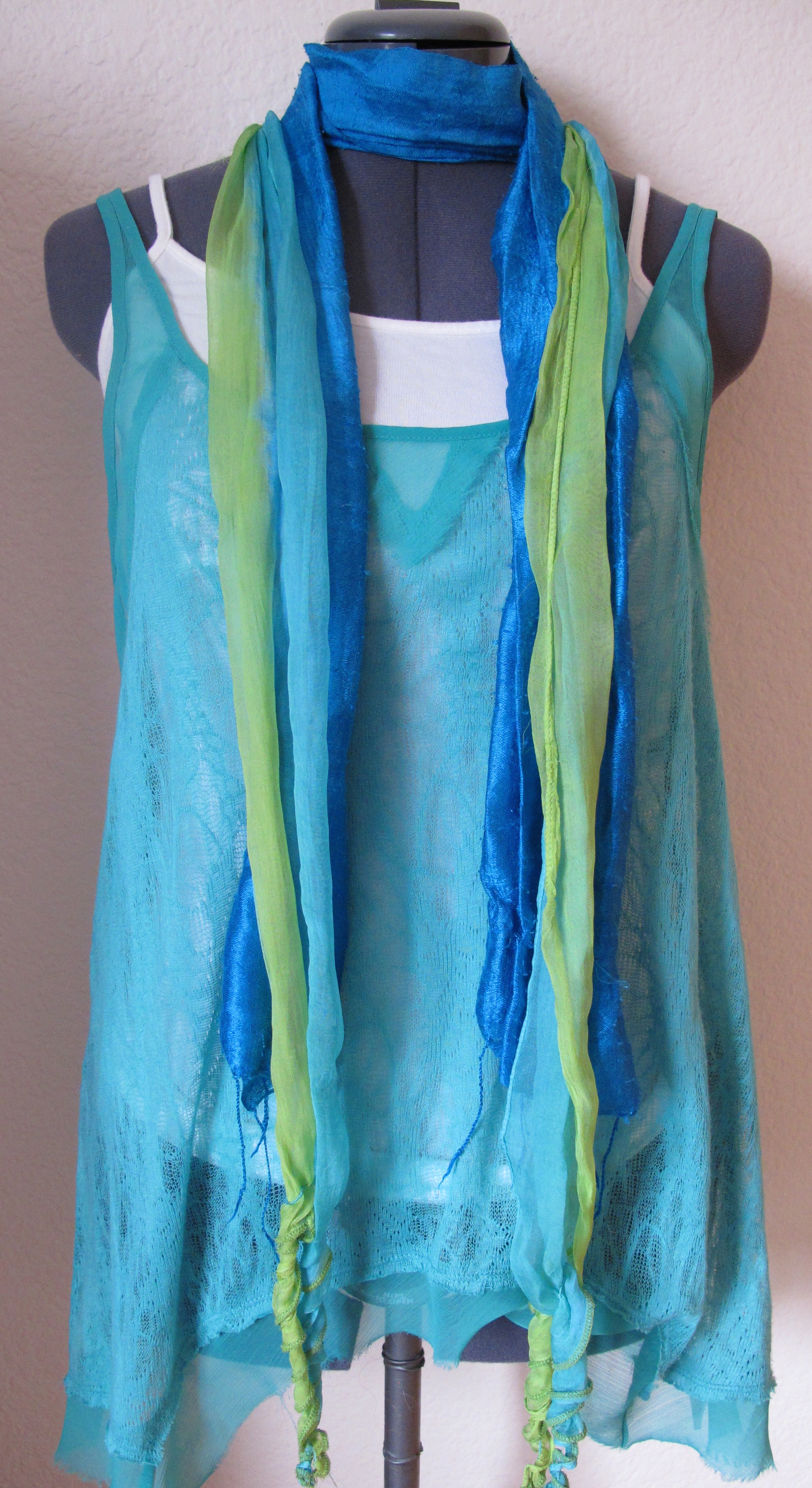 Two scarves, a solid blue and a light chiffon in blue and green.