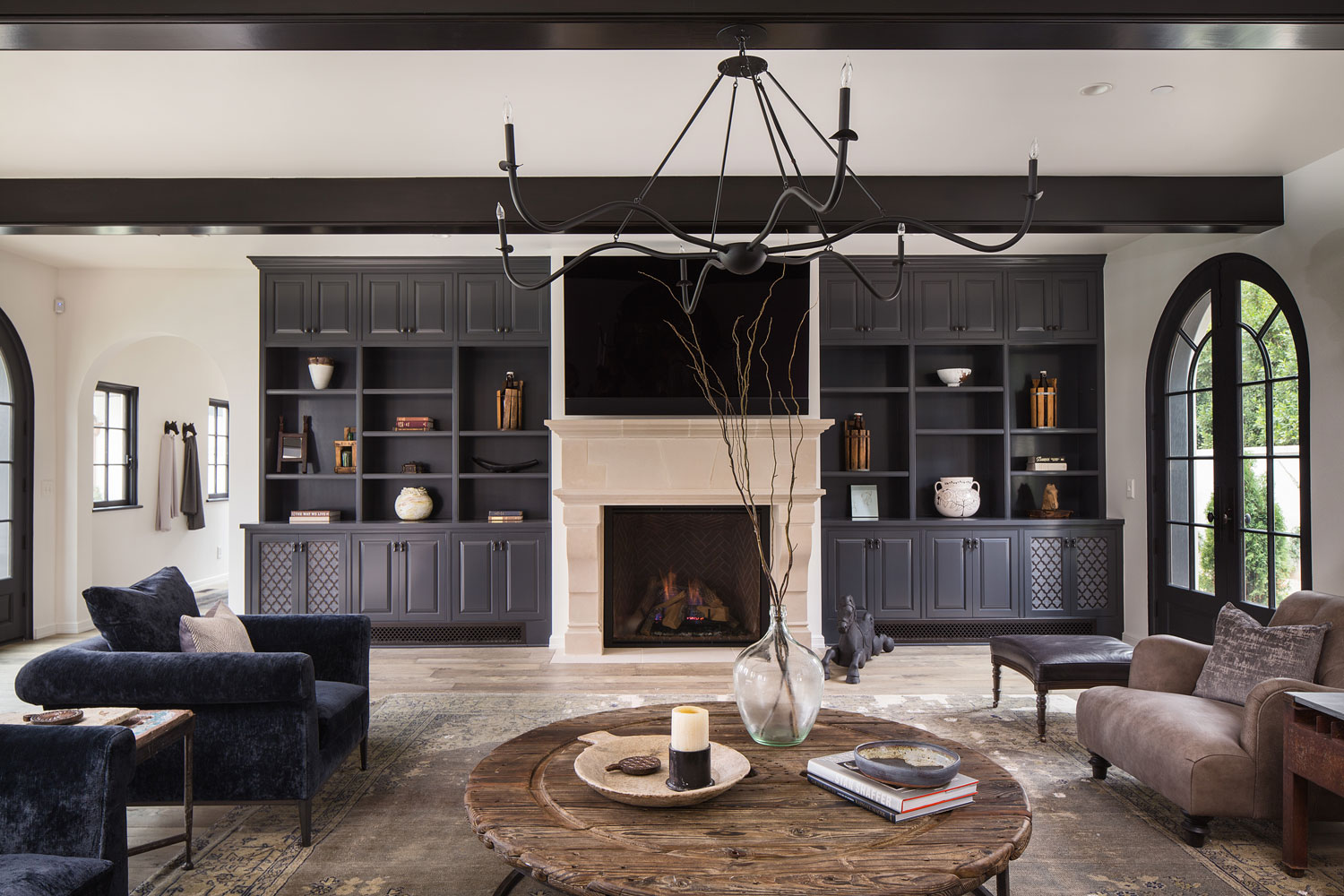 beamed-ceiling-built-in-cabinets-fireplace-chelsea-construction.jpg