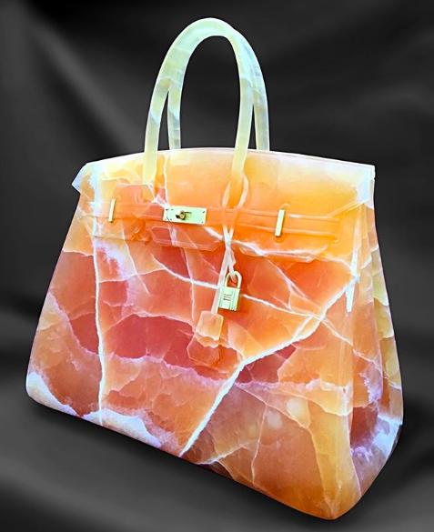 Orange calcite Birkin Bag sculpture by Barbara Segal