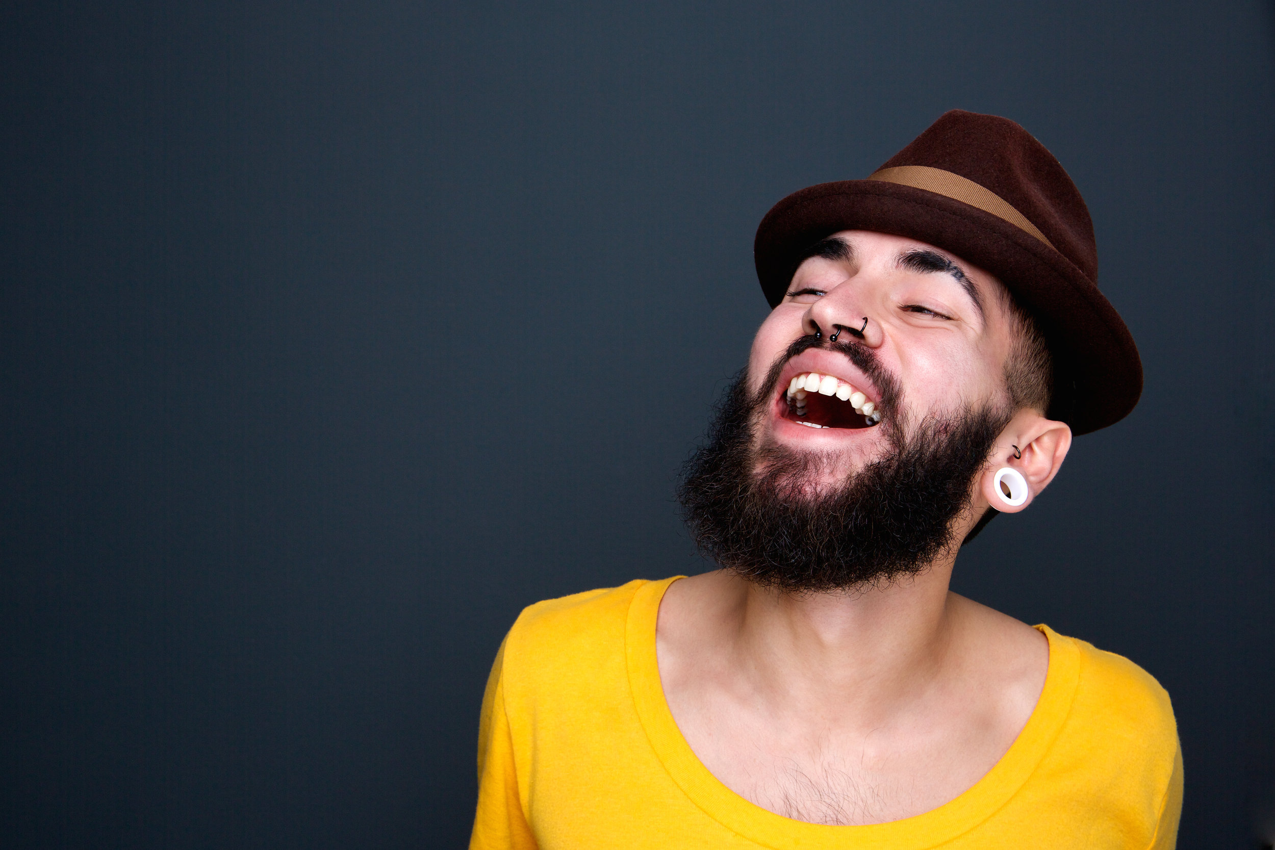 man-with-beard-and-hat-laughing-PHN6LEJ.jpg