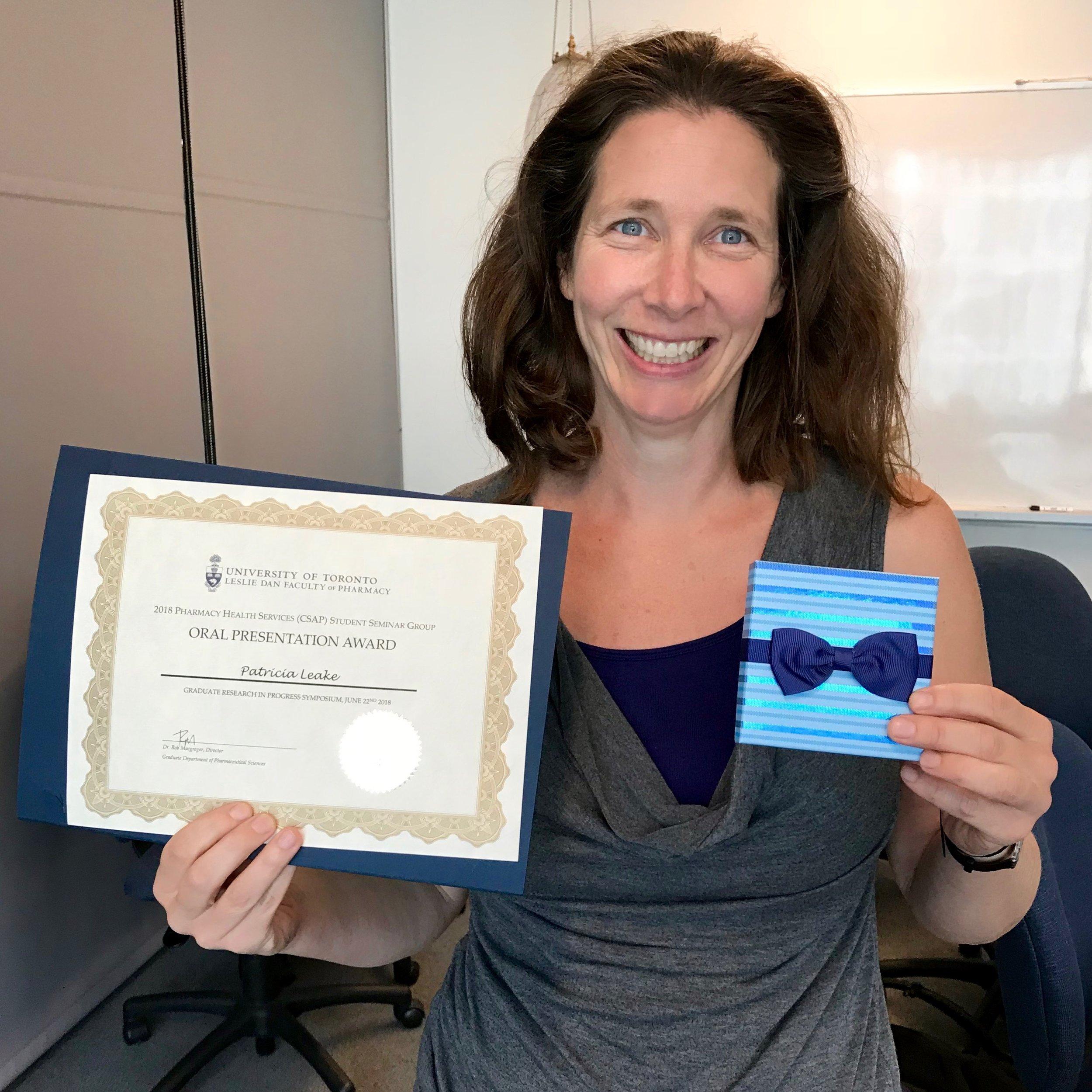 Patti Leake celebrates her best presentation award.
