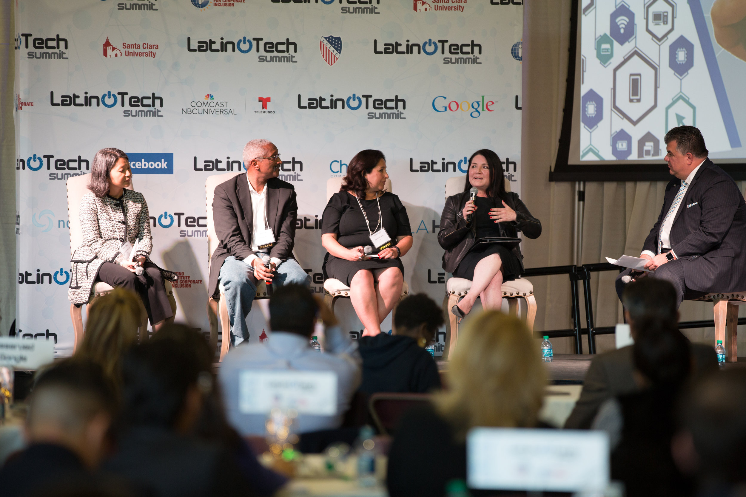Representatives from Comcast, GE Digital, Intuit, HITTec, and SAP Labs discuss the importance of fostering inclusive work environments in tech.