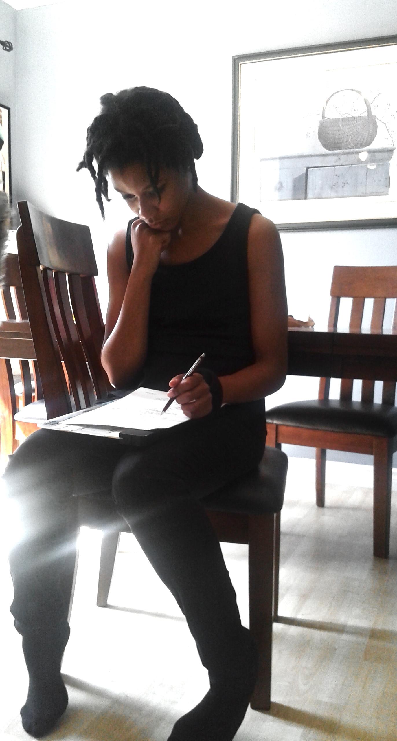 Jamara Forbes, filmmaker, with paperwork